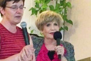 Suellen speaking in Poland with an Interpreter.